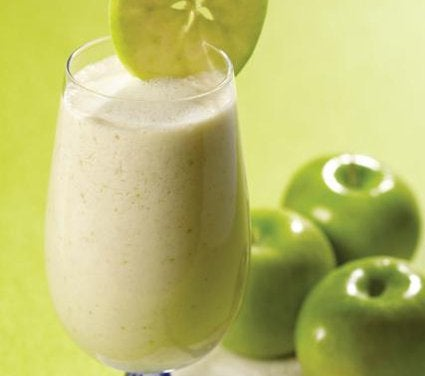 An apple smoothie in a glass.
