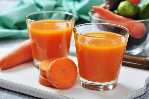 Some carrot juice in glasses.