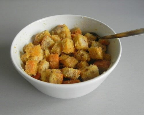 Croutons in a bowl with a spoon.