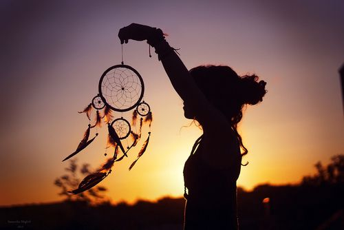 A woman with a dreamcatcher.
