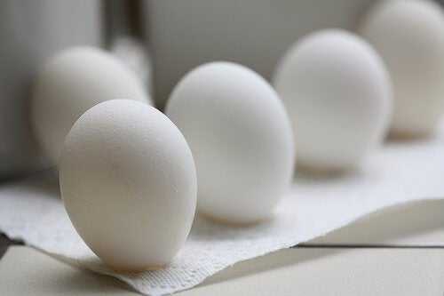 Some white eggs on tissue paper.