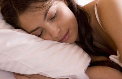 Woman asleep on pillow