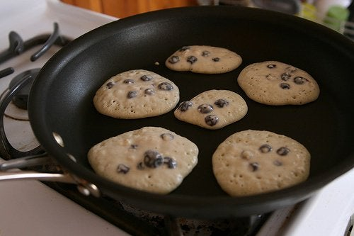 Cooking some biscuits in a pan.