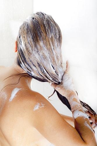 Woman with foamy wet hair ways to lighten your hair