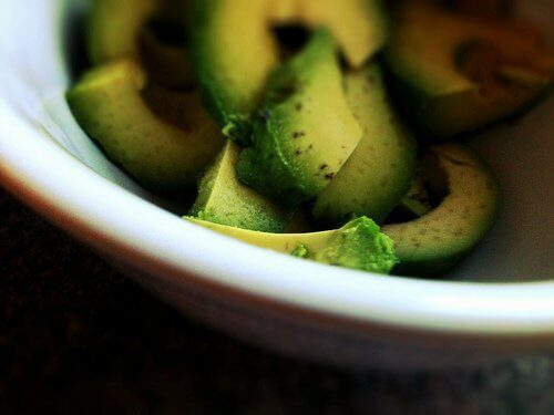 Natural remedies with avocado chopped in bowl