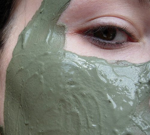A woman with a clay mask.