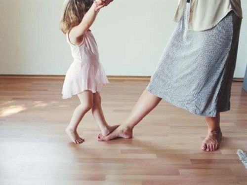 Mother and daughter dancing.