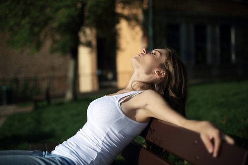 A woman asleep in the sun.