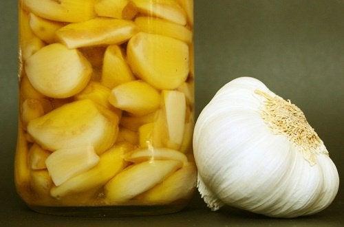 Cloves of garlic in a jar