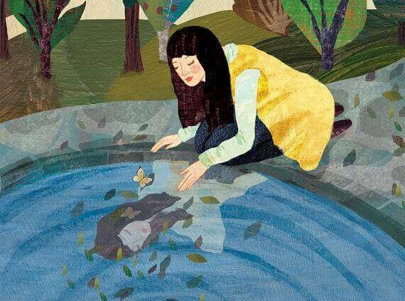 Nainen veden äärellä