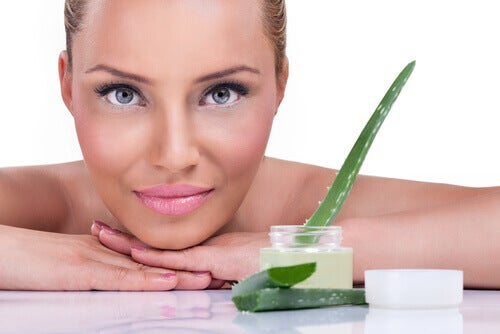 A woman with some aloe vera cream.
