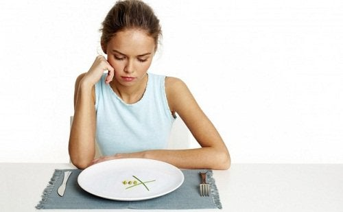 A woman engaging in extreme portion control.