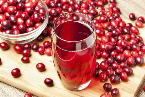 Cranberries and a glass of cranberry juice.