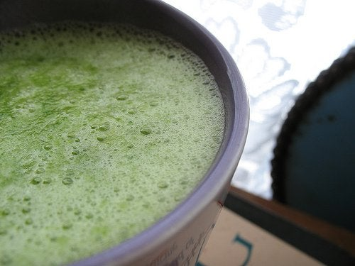 Green diet smoothie for breakfast with fruits and vegetables