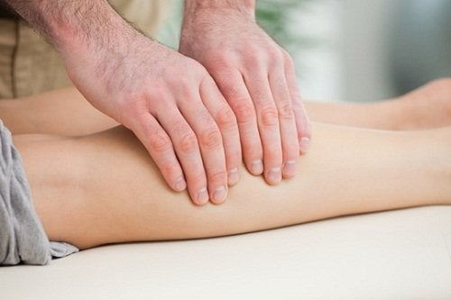 massaging leg muscles to treat cramps