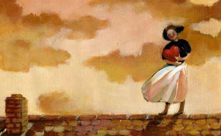 Woman standing on roof with heart in her hands