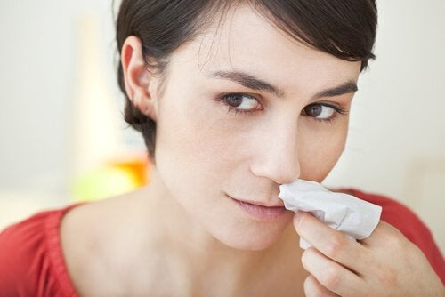 A woman suffering from nosebleeds.