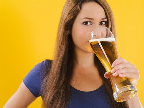 A woman drinking beer.