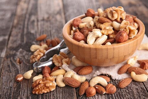 Assorted nuts in a wooden bowl.