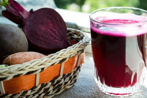 a basket of beets and a glass of beet juice