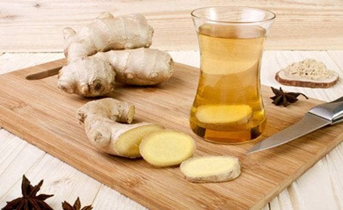 A glass of ginger tea.