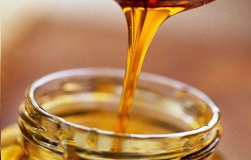 Pouring honey into a jar