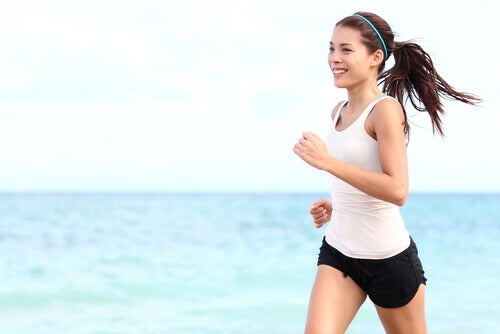 A girl jogging by the sea.