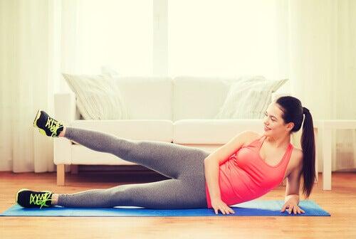 A woman doing leg raises.
