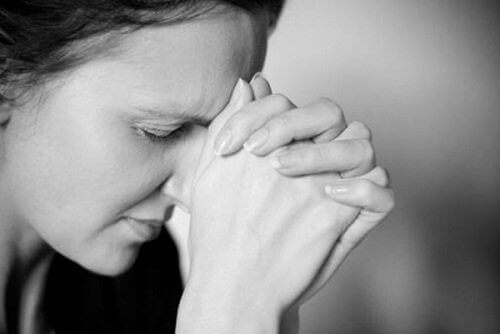 Woman bowing head in anxiety frustration depression