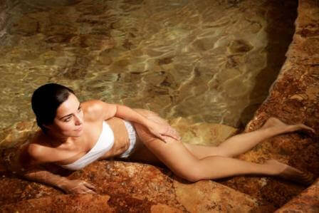woman in a hot pool as a cellulite treatment
