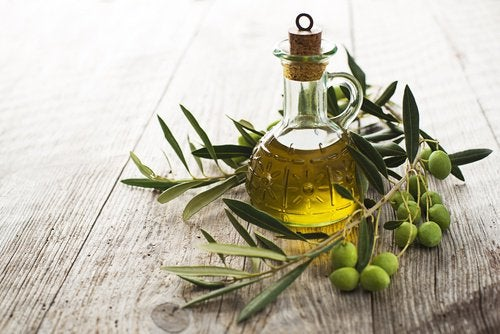 A jar of olive oil with olives
