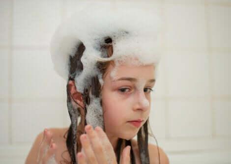 A child washing their hair.