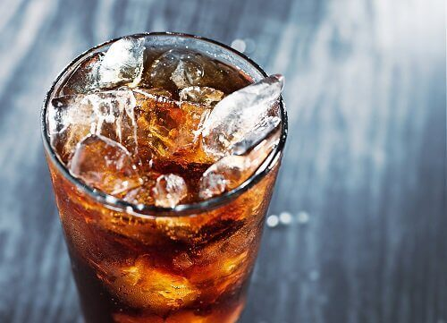 Glass of cola caffeine with ice effects of energy drinks on your health