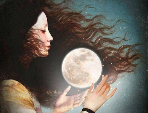 Woman holding the moon between her hands
