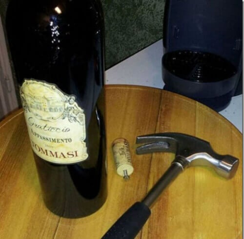 a homemade trick to open a wine bottle without a corkscrew