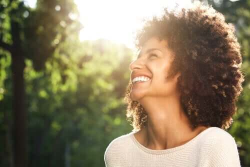 A woman at peace, smiling.