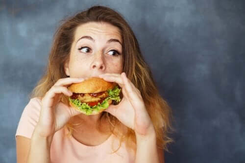 A woman eating a burger.