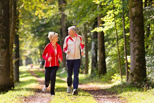 2 elderly people jogging