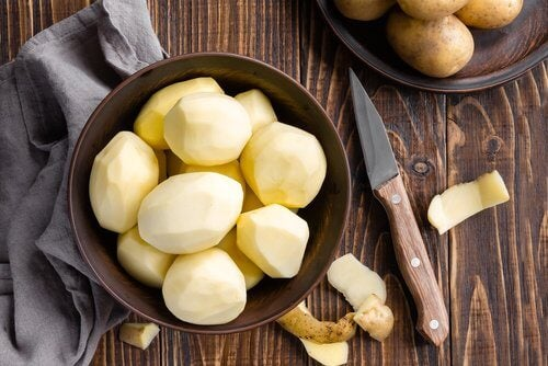 Peeling potatoes to make potato juice for healthier hair
