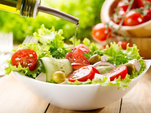 Adding dressing to a salad