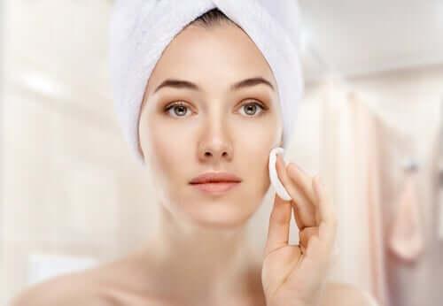 A woman moisturizing her skin.