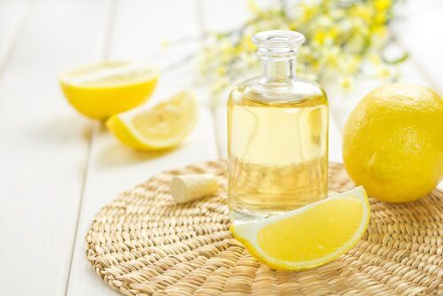 Some lemons and lemon essential oil.