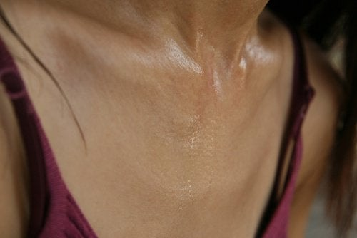 A woman with a sweaty chest.