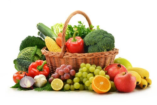 A basket full of fruit and vegetables.