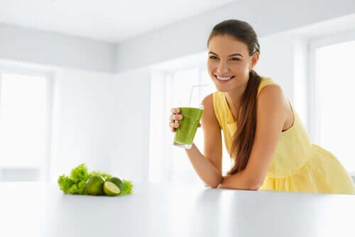 A woman happy she's drinking a natural remedy to lower cholesterol.