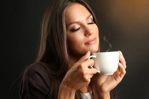 A woman with a hot drink.