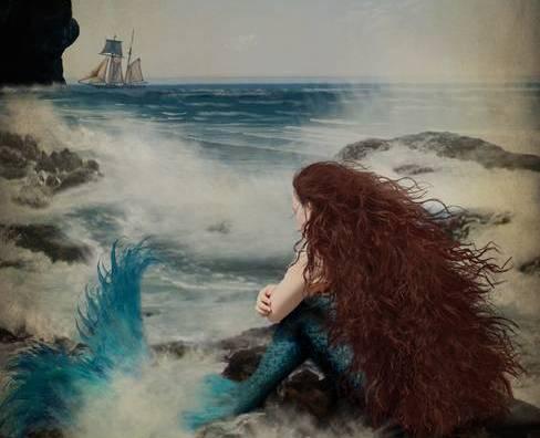 Mermaid looking at boat