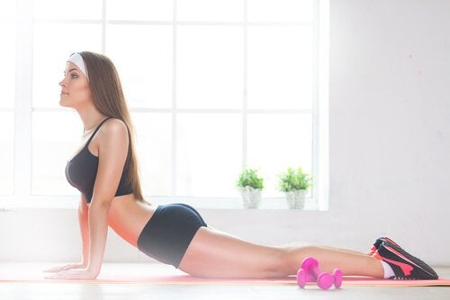 Woman stretches abdominal muscles lose belly fat