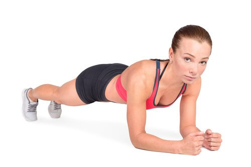 Woman doing plank lose belly fat