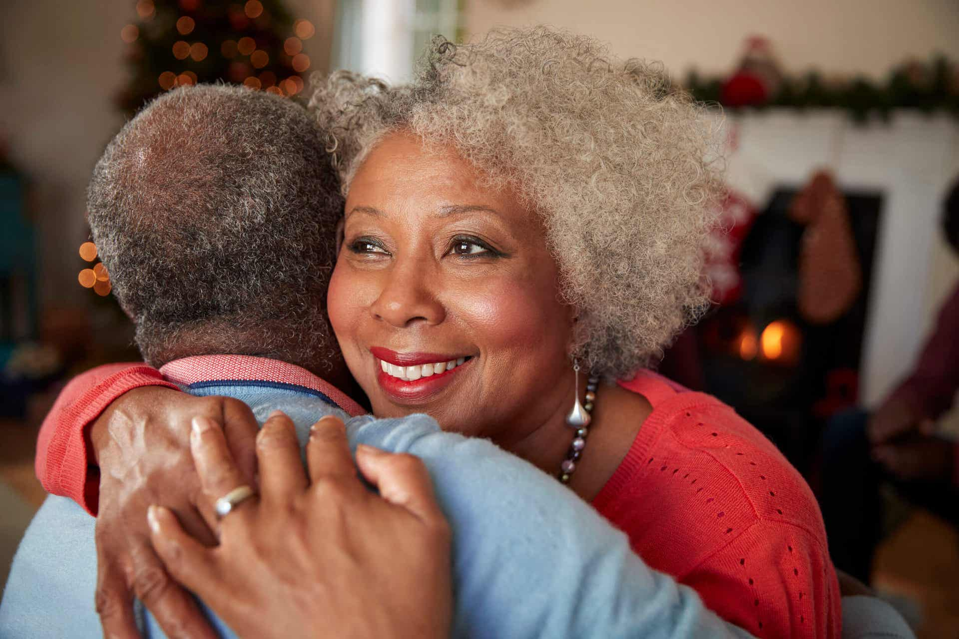 An older couple embracing.